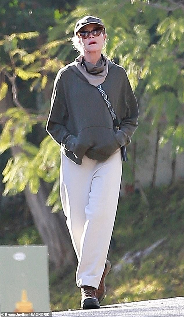 Keep fit: Melanie Griffith, 63, went out on one of her near daily walks around her Beverly Hills neighborhood on Saturday