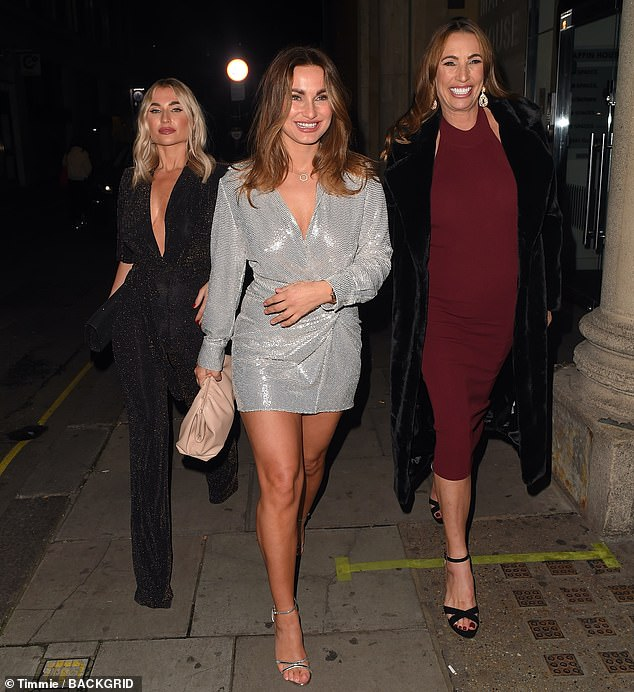 Commanding attention:Influencer Billie, 30, stunned in a plunging black jumpsuit, while matriarch Suzie, 51, looked elegant in a burgundy midi dress