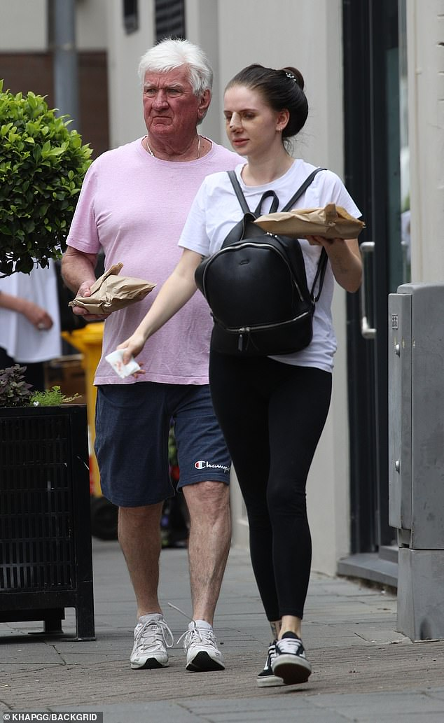 Family man: Legendary NRL commentator Ray Warren (left) stepped out with his daughter Holly (right) in Sydney's Double Bay on Monday, after she underwent cosmetic nose surgery