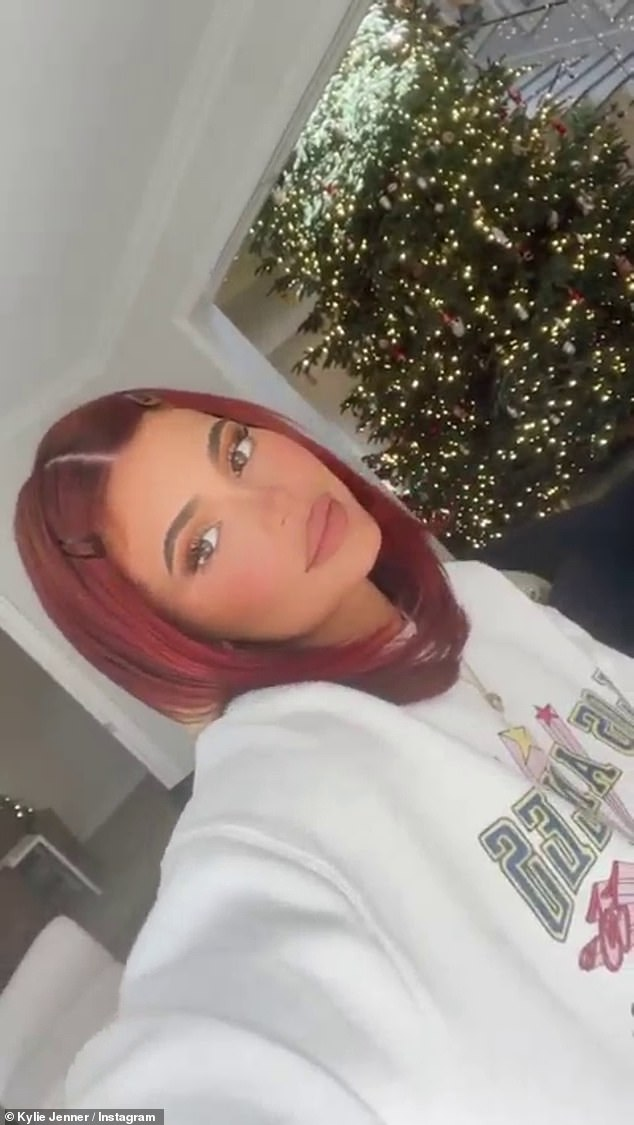 Rocking the real: `` my real hair is curvy.  I have to give her more love, '' wrote Jenner, who wore the Los Angeles sweatshirt featured in the photos with Psalm.