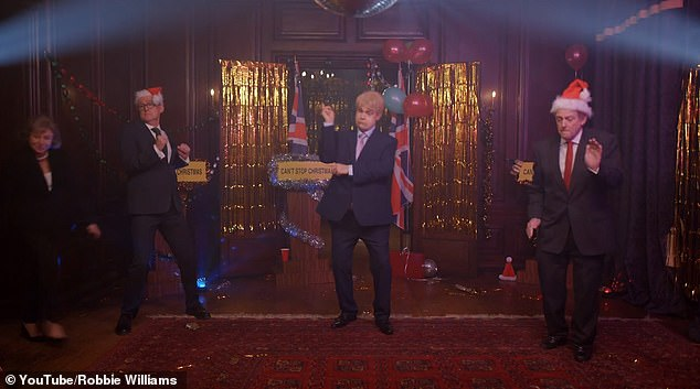 Amusing: Robbie displayed his own smooth dance moves in a festive-decorated version of the briefing room