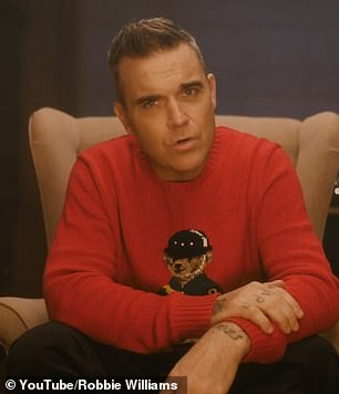 Fun: Robbie Williams released the video for his new single Can't Stop Christmas on Monday