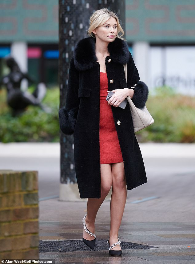 Stylish: Georgia highlighted her slender physique in the eye-catching red mini dress which she teamed with a cosy black coat