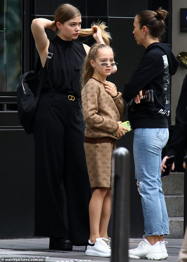 Professional:Mia looked chic in an all-black outfit in a plated halterneck blouse, and wide-leg trousers with a designer Dior leather belt