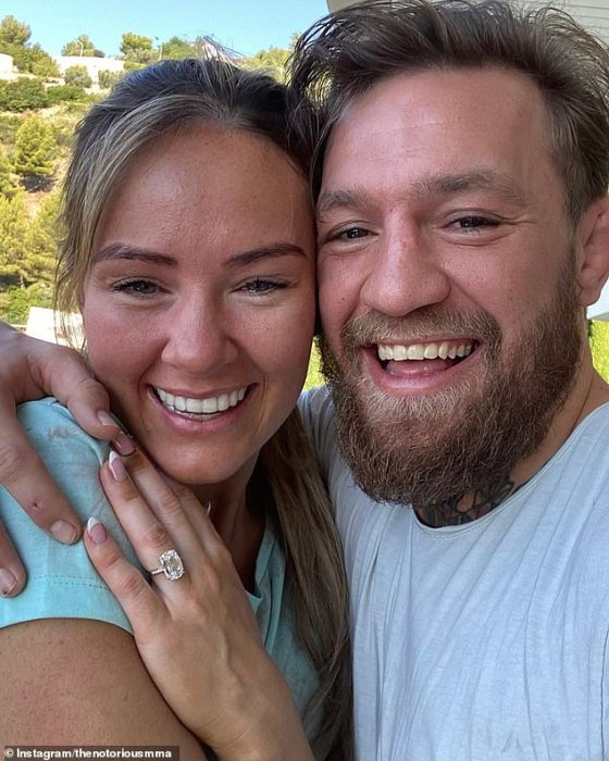 Paul also took gross insults at McGregor's longtime girlfriend Dee Devlin (pictured with McGregor after announcing their engagement)