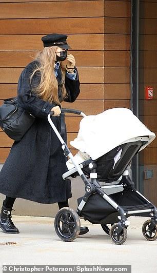 Model Behavior: Gigi showed her ultimate fashion sense with a black jacket that fell below her knees