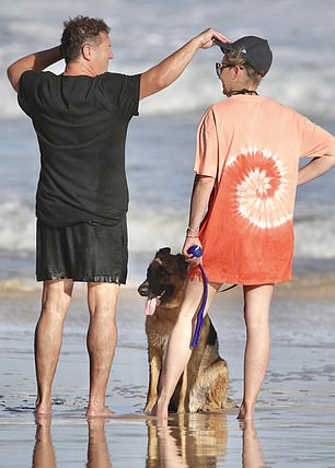 Beach date: He was joined by his wife of two years, Jasmine Yarbrough, and their beloved German Shepherd, Chance the Yapper