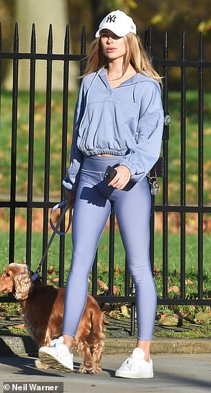 Relaxed: Nailing effortless style, the former Made In Chelsea star looked typically radiant in a baggy cropped jumper and running tights