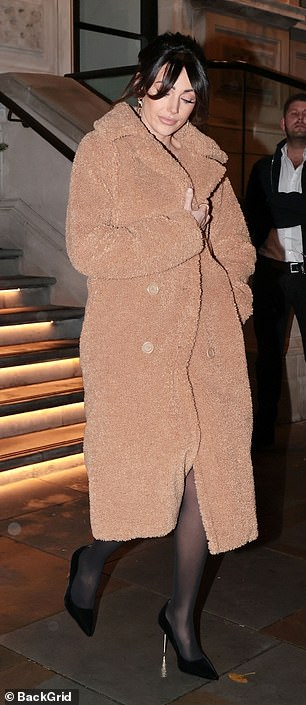 Stunning: The actress wrapped up against the dismal London weather in her chic but cosy coat