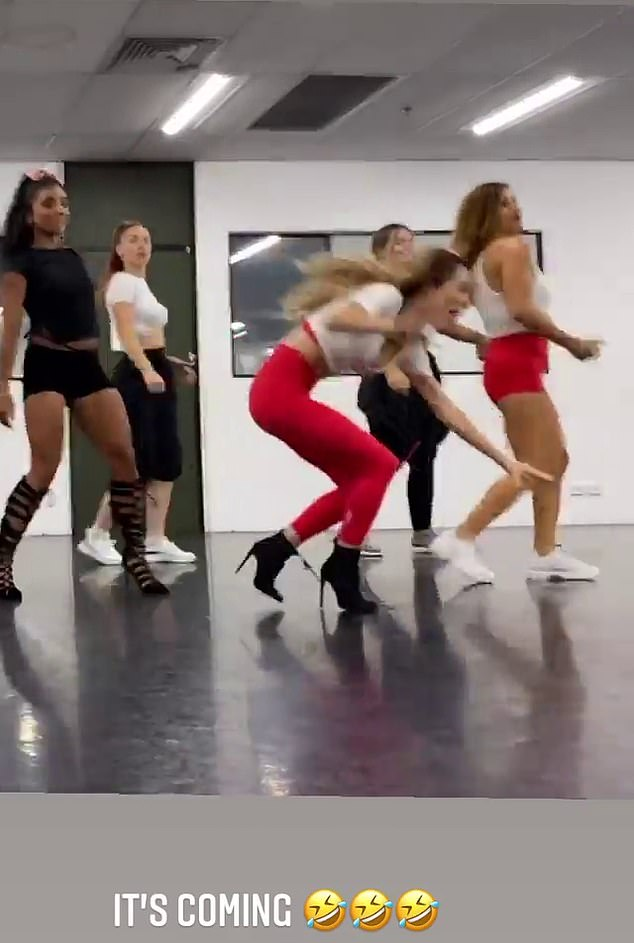 Whoops!Towards the end of the clip, she spun around and appeared to trip up over the laces of her heeled boots, as the class erupted in laughter