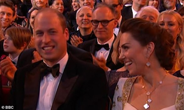 Cracking up:The Duke and Duchess of Cambridge were seen awkwardly laughing on Sunday night after Margot Robbie quipped about Megxit during a BAFTA acceptance speech