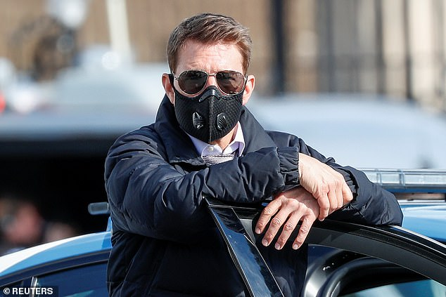 Oh no! Tom Cruise has been repeatedly wearing a $14.99 face mask on set of Mission Impossible 7 which is NOT recommended by the CDC following his two furious rants over staff breaking Covid rules (pictured on October 13)