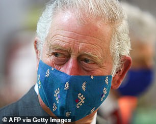 Prince Charles, who appeared in high spirits during the visit, opted to wear his turquoise face covering for the occasion