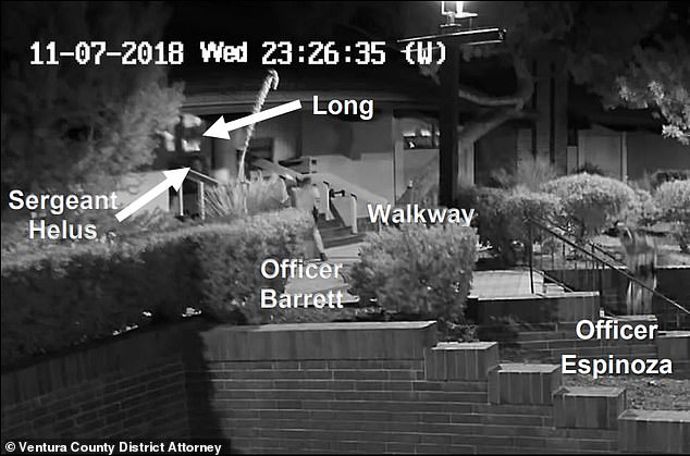 An annotated still of the footage shows the officers' positions outside