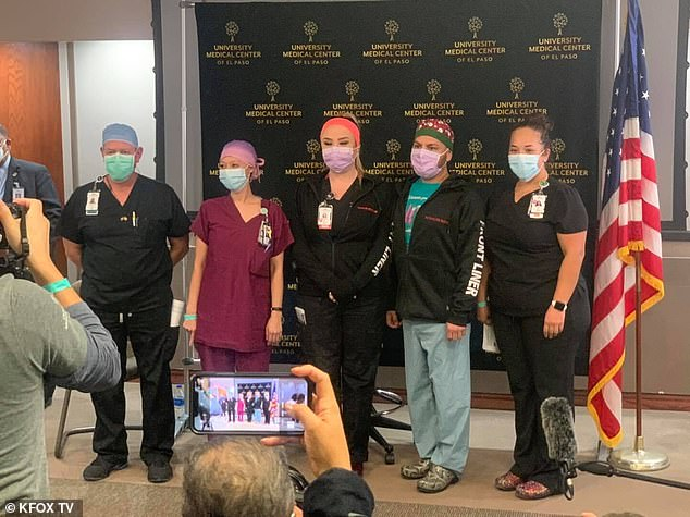 The five nurses from The University Medical Center in El Paso, Texas, pictured at a press conference after receiving some of the first COVI-19 vaccines at the hospital on Tuesday. Ricardo Martinez (far left) was later vaccinated again to 'strengthen confidence' in the vaccine after TV viewer complaints that his dose wasn't real. There were no reported problems with the other vaccinations