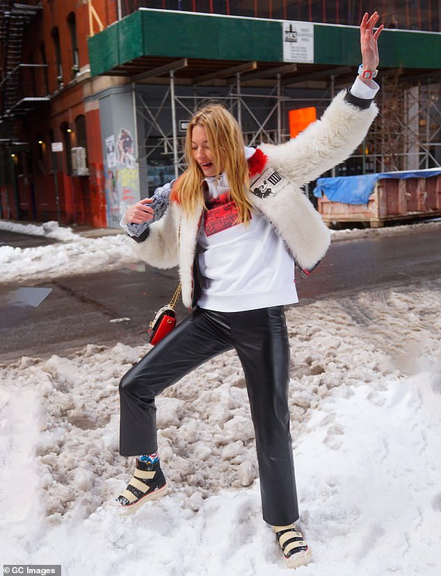 Slight stumble: During the photoshoot, Hunt seemed to lose her footing in the snow, but later regained her composure