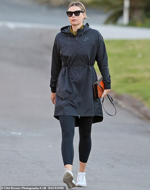 Looking fab:Maria Sharapova was spotted enjoying a drive and a stroll out in Manhattan Beach, California this Friday