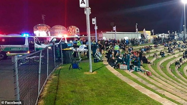 Paramedics tried to save bikie boss Nick Martin as shocked families watched in horror after the shooting on Saturday night. Pictured: paramedics at the scene