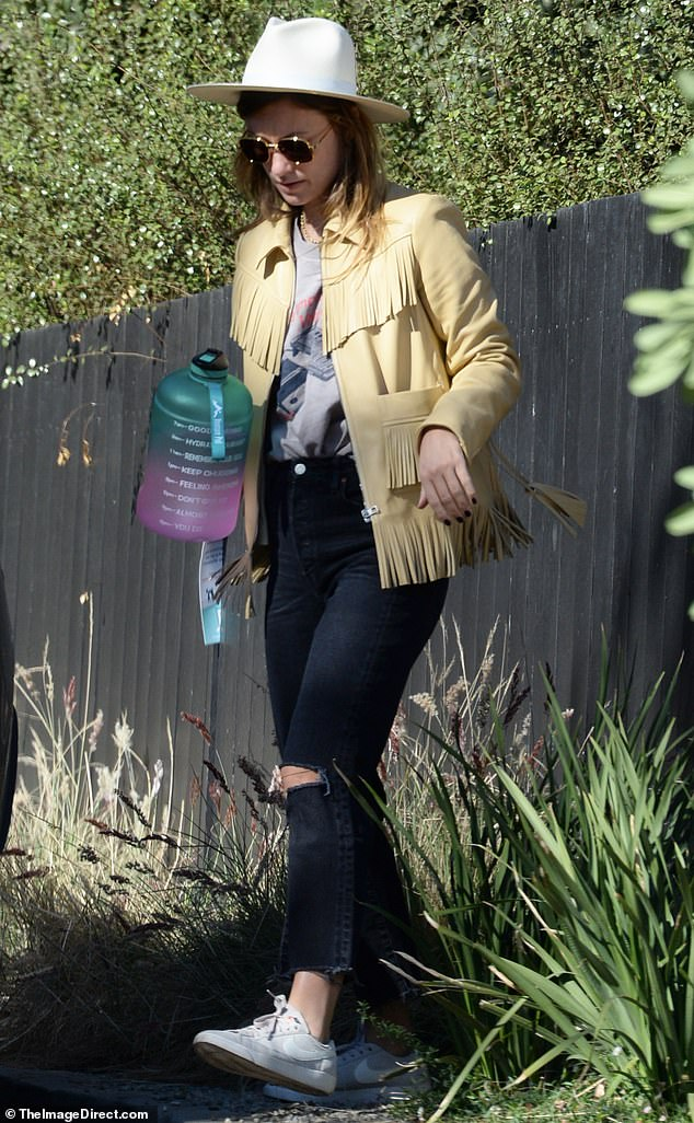Fringe moment: Olivia Wildeexecuted the perfect fringe moment Saturday as she went yee-haw chic in a white stetson to pick up her kids Otis and Daisy at ex Jason Sudeikis' house in Los Angeles