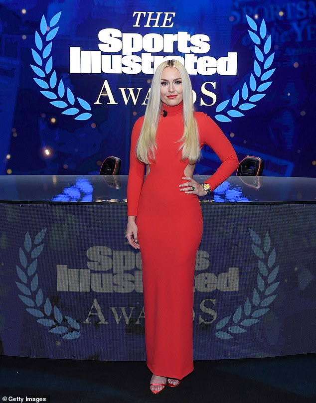 Lindsey Vonn poses in a red dress during a break in filming the 2020 Sports Illustrated Awards