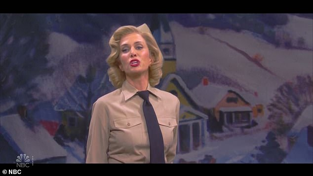 Musical number: Wiig is introduced as the troop's nurse, as she prepares to sing a song, but calls up a soldier (Bowen Yang) to help her