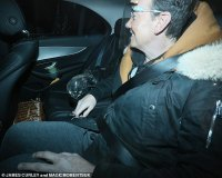Strictly judge Craig Revel Horwood leaves the studios with his WINE GLASS in tow after the final