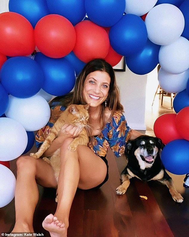 So cute! She also posted a sweet video of herself reuniting with the animals - complete with a balloon arch to celebrate - alongside the caption: 'What happiness looks like'