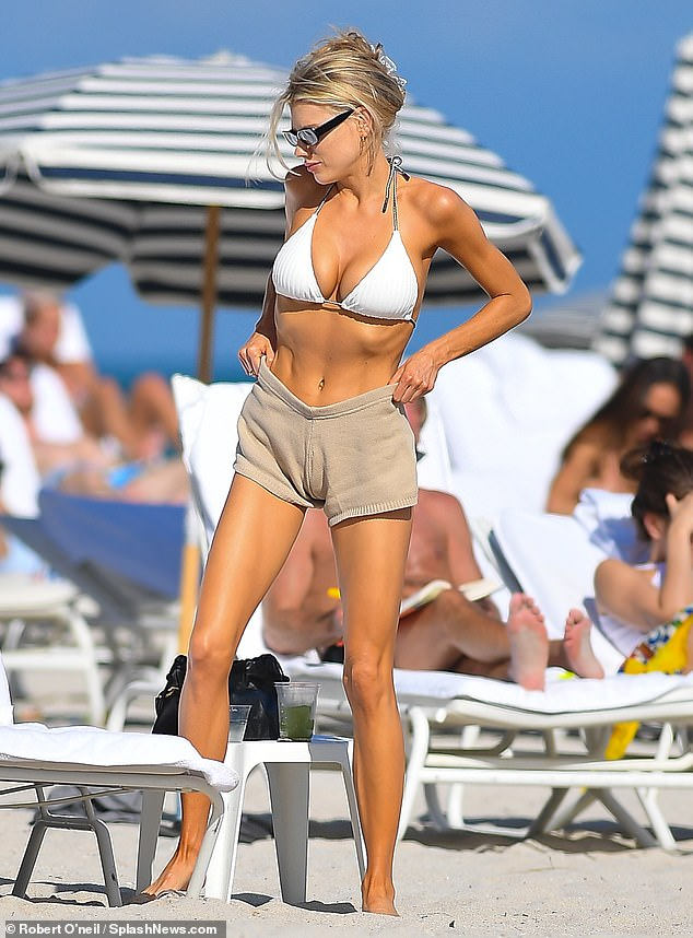 Charlotte McKinney puts on a busty display in a bikini top as she enjoys a day at the beach in Miami
