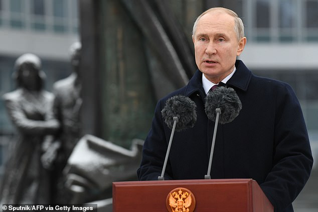 Vladimir Putin gave his personal backing to Russia's SVR foreign intelligence agency at an event commemorating its 100th anniversary on Sunday in Moscow (pictured). The event came days after the SVR was accused of launching a massive cyberattack against the US