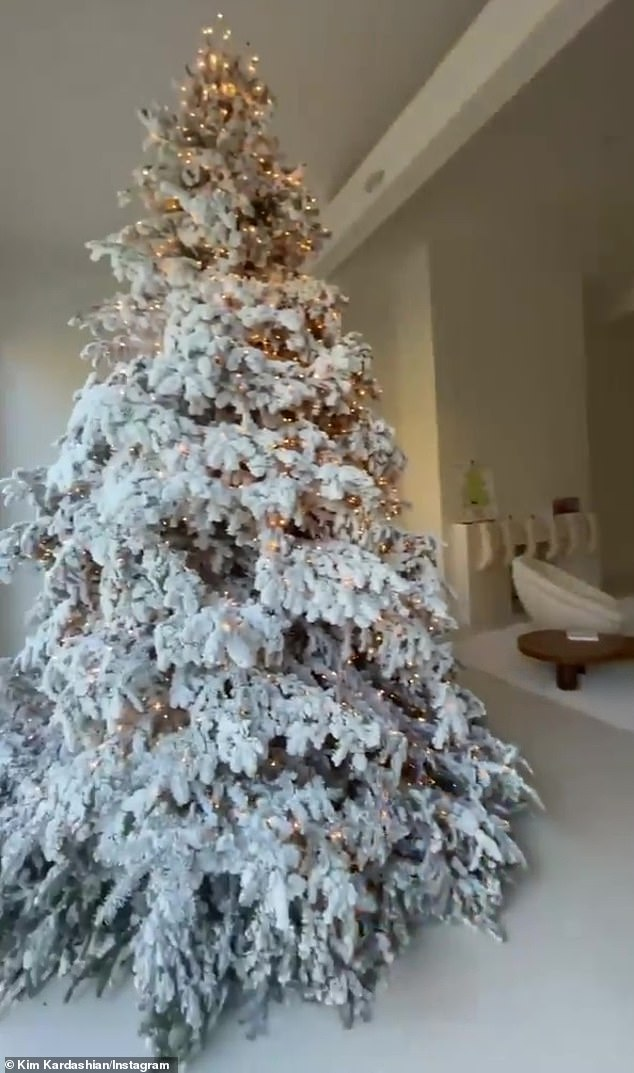 Winter wonderland: Kim Kardashian, 40, showed off some of her tastefully minimalist home decorations to Instagram on Sunday, including her snow-frosted tree