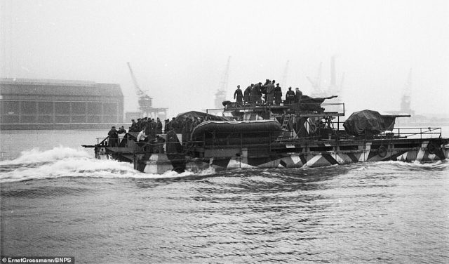 One of the heavily armed invasion crafts powers out to sea from Antwerp in 1940.The craft were designed to run onto the beaches and were capable to transporting hundreds of troops, tanks and heavy artillery
