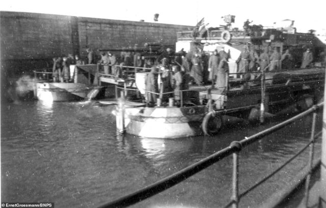 The 80ft long catamarans were made using heavy bridge pontoons that formed the two hulls 40ft apart and a superstructure built on top. Pictured:Crew on a landing craft as it leaves harbour
