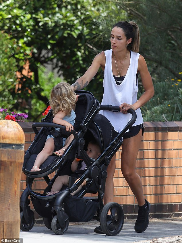 Shining bright! Sarah Boulazeris showed off her stunning diamond ring as she enjoyed a walk in Melbourne with her two daughters on Thursday