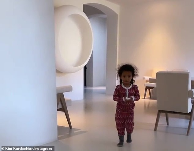 Sleepy:Kim's daughter Chicago appeared to wake up from the piano music and hesitantly walked into the room while still dressed in her red patterned pajamas