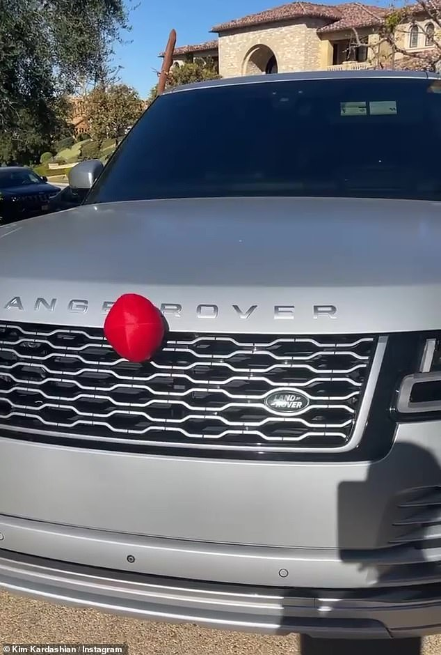 New frontier: Later on Sunday, Kim showed how her silver Range Rover had been decorated for the holidays. 'I don't know what has happened to me, but I've turned into this person'