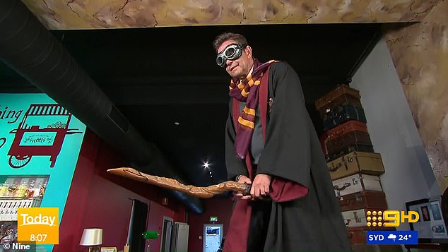 Steve Jacobs pretends to ride a broomstick while dressed as Harry Potter as fans see awkward detail