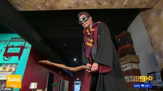 Steve Jacobs pretends to ride a broomstick while dressed as Harry Potteras fans see awkward detail