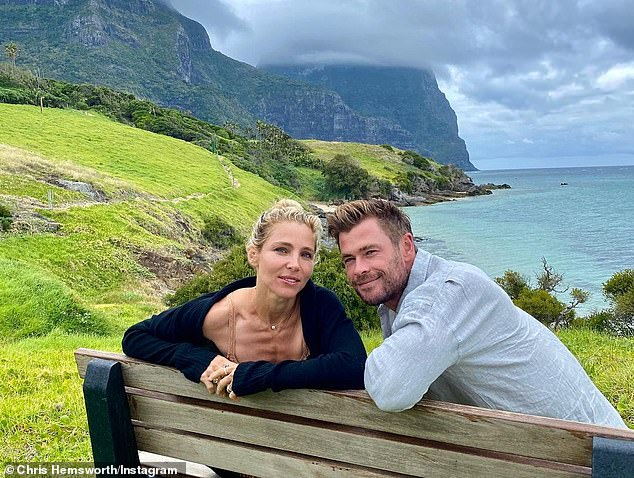 Chris Hemsworth jumps into a lake as his wife Elsa Pataky relaxes nearby during family outing