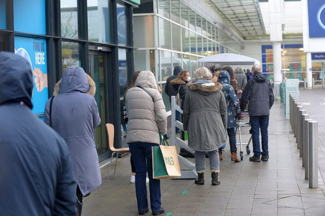 Queues formed outside Cardiff's Marks and Spencers today as peoplerushed to the shops to do last minute Christmas shopping