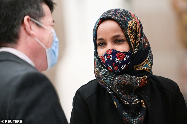AOC has also come under fire for getting the jab from some of her own. Rep. Ilhan Omar (above) called it 'disturbing' that members of Congress were getting the coronavirus vaccine before frontline workers and the elderly
