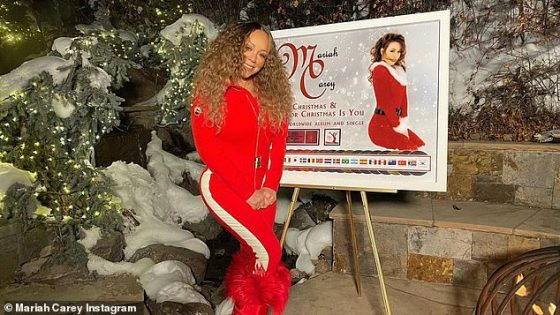 Surprise!  Mariah was surprised by a plaque from her record label recognizing the worldwide 'multi-platinum' success of her holiday album Merry Christmas and the single All I Want For Christmas Is You on Monday.