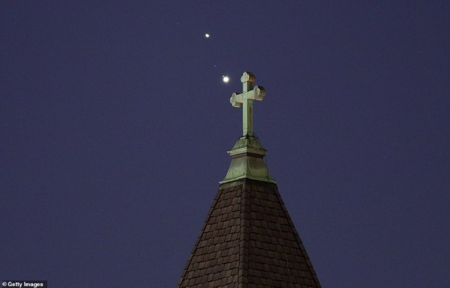 Saturn and Jupiter close to each other in the night sky above Jersey City, New Jersey, on December 18, 2020 (pictured)