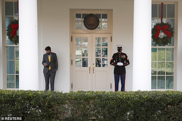 Republican Rep Matt Gaetz of Florida checks his phone outside the West Wing; he was at Monday's White House meeting that House Republicans held with President Trump and Vice President Mike Pence