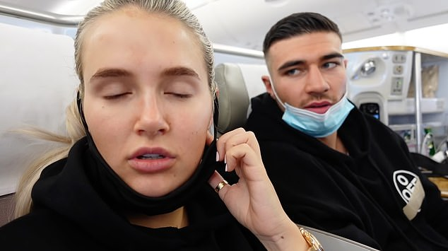 Mask slip: Molly-Mae and Tommy pictured on the plane over to Dubai