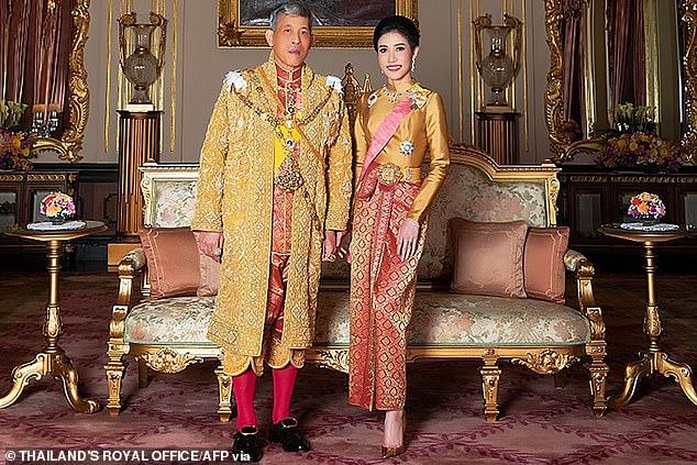 Thailand's King Maha Vajiralongkorn poses with royal noble consort Sineenat Bilaskalayani, also known as Sineenat Wongvajirapakdi, in his Royal Office on August 26, 2019