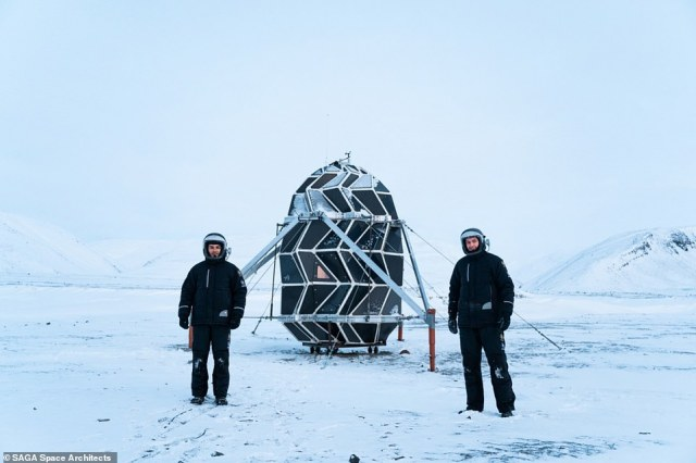 Sebastian Aristotelis (left) and Karl-Johan Sørensen (right) - two 'space architects' and employees of the Danish firmSAGA Space Architects, standing outside their fully extended shelter,Lunark