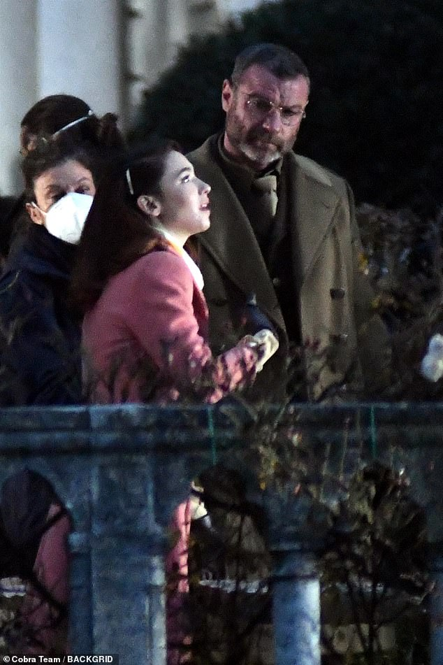 Drama: The Undoing star, 25, transformed into a wartime beauty for the night shoot, which saw her and Liev share an intimate conversation while strolling through a garden