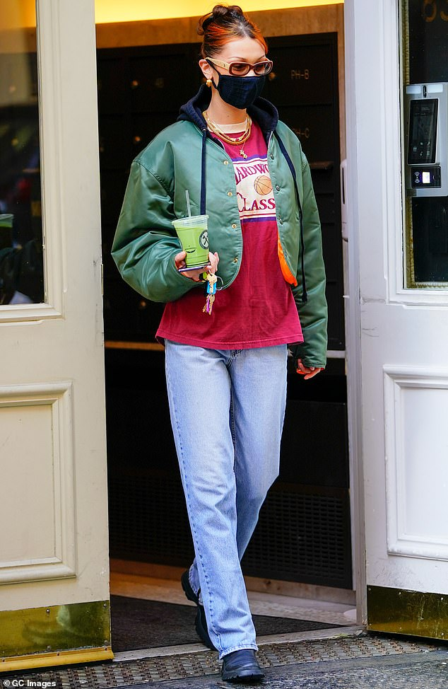 Looking good! On Tuesday, Bella Hadid layered up in a puffy green jacket and a pair of vintage jeans as she took a walk in New York City