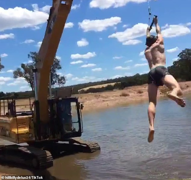 The clip showed the shirtless larrikin dangle from a rope attached to the machinery at a rural farm as one of his mates, who sat in the control box, swung him through the air
