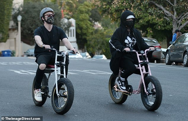 Hitting the pavement: Billie Eilish and her brother and producer Finneas were spotted riding their bikes through the streets of Los Angeles on Monday